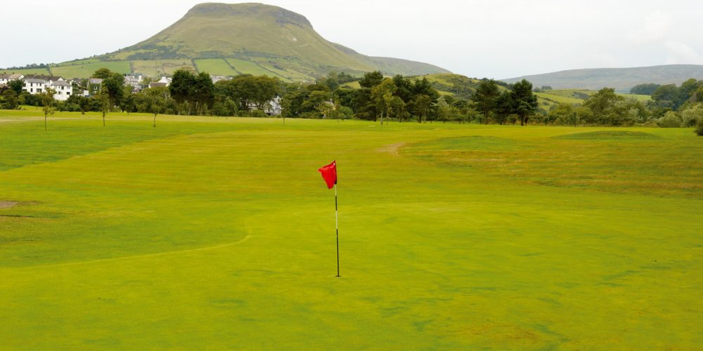 Cushendall Golf Clubfounded in 1937 and affiliated to the G.U.I. in 1938, Cushendall Golf Club nestles at the foot of the beautiful Glenballyeamon in the celebrated Glens of Antrim. This small, picturesque nine-hole course is bounded by the quaint village of Cushendall (known as the capital of the Glens) on the landward side, while the waves of Red Bay pound its northern shores.